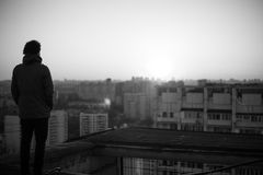 Young boy silhouette on the roof Stock Images
