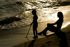Young boy and silm mother together at the beach Royalty Free Stock Photo
