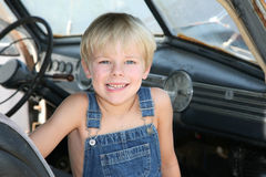 Young boy sitting in an antique car Stock Photos