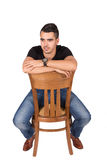 Young boy sitting on a chair Stock Photography