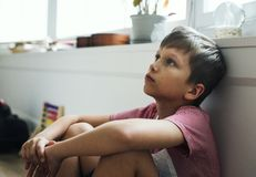 Young boy sitting with depression Stock Photos