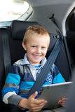 Young boy sitting holding a tablet Royalty Free Stock Image