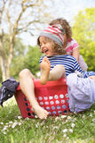Young Boy Sitting In Laundry Basket Royalty Free Stock Photos