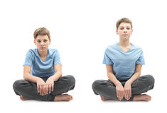 Young boy sitting in a lotus position Stock Images