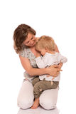 Young boy sitting on mother lap Royalty Free Stock Image