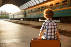 Free Young Boy Sitting On Suitcase Royalty Free Stock Image - 95433666