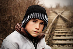 Young boy sitting on the railways Royalty Free Stock Images