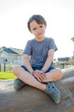 Young boy sitting on a rock Royalty Free Stock Images