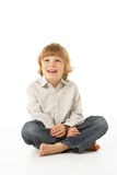 Young Boy Sitting In Studio Royalty Free Stock Photography