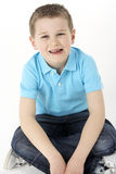 Young Boy Sitting In Studio Royalty Free Stock Images
