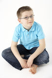 Young Boy Sitting In Studio Stock Photography