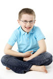 Young Boy Sitting In Studio Royalty Free Stock Photos
