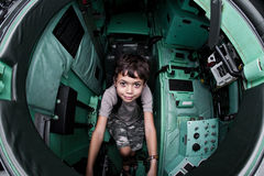 Young boy sitting in a tank Royalty Free Stock Image