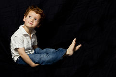 Young boy sitting and thinking Stock Photography