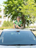 Young boy sitting on the top of a car looking up Royalty Free Stock Photos