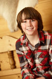 Young Boy Sitting On Wooden Seat Stock Photos