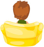 Young boy sitting on yellow chair Royalty Free Stock Photography