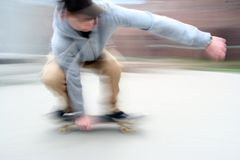 Young boy on a skate board Stock Photography
