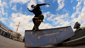 A young boy on a skateboard doing trick on the brink stock video footage