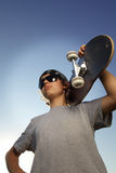 Young boy with skateboard in hand Royalty Free Stock Image