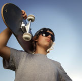 Young boy with skateboard in hand Stock Photo