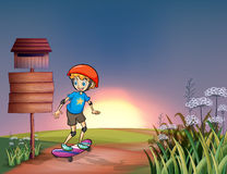 A young boy skateboarding in the hills. Illustration of a young boy skateboarding in the hills Stock Images