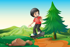 A young boy skateboarding at the hilltop Stock Photography
