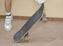 Young Boy Skating. Young boy jumping with his skateboard Royalty Free Stock Photos