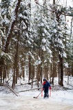 Young boy skating on a frozen pond. Little boy ice skating on a frozen pond in a forest Stock Photos