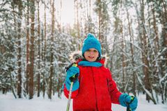 Young boy ski in winter nature, seasonal sport. Young boy ski in winter nature, kids seasonal sport royalty free stock image
