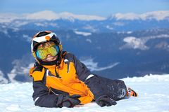 Young boy skier on mountain. Smiling young boy skier on snowy mountain with helmet and face mask or goggles Stock Photos