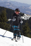 Young boy skiing Stock Photos