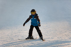 Young boy skiing. Young boy learning  to downhill ski Royalty Free Stock Image