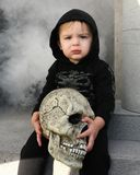 Young boy with skull Royalty Free Stock Photos
