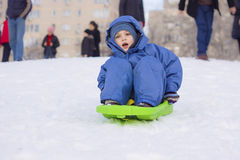 Young boy on sledge stock photo