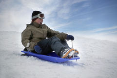 Young boy on sledge. Young boy going down a slope on a sledge Stock Images