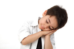 Young boy sleeping acting. Young boy in studio acting sleeping Royalty Free Stock Images