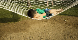 Young boy sleeping  in beach hammock Stock Image