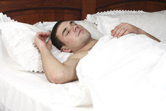 A young boy sleeping in bed Royalty Free Stock Photos