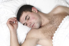 A young boy sleeping in bed Royalty Free Stock Photo
