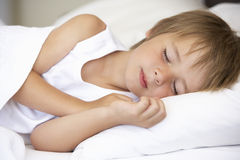 Young Boy Sleeping In Bed Stock Photos
