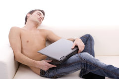 Young boy sleeping on couch Stock Images