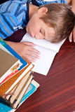 Young boy sleeping on his desk Stock Images