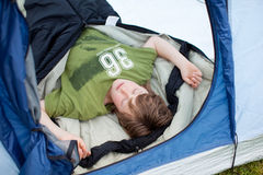 Young Boy Sleeping In Tent Stock Photo