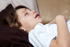 Young boy sleeps on sofa Stock Image