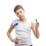 Young boy in a sleeveless shirt Royalty Free Stock Photos