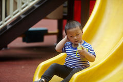 Young boy on slide Royalty Free Stock Photo