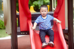 Young boy on slide Royalty Free Stock Image