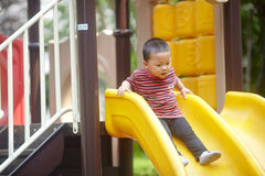 Young boy on slide Royalty Free Stock Photography