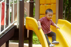 Young boy on slide Stock Photos